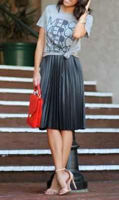 Styling graphic tee with a pleated midi skirt.