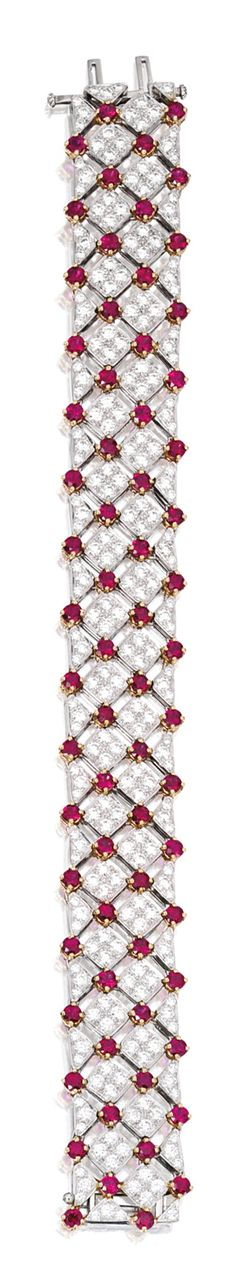PLATINUM, 18 KARAT GOLD, RUBY AND DIAMOND 'TRELLIS' BRACELET, TIFFANY & CO. Set with 64 round rubies weighing 9.11 carats accented by 225 round diamonds weighing 9.13 carats, length 7 inches, signed Tiffany & Co., numbered 803754.