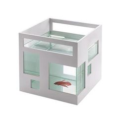 This award winning fish bowl by Umbra boasts an ABS white plastic outer shell with asymmetrical windows and a square glass inner bowl that is removable for easy cleaning. Stack a couple of the fish studios to create a stylish and contemporary fish hotel or condo in your home or office. The outer shell can be painted to match your space.