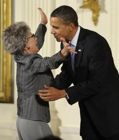 Rita Moreno Hug U.S. President Barack Obama hugs Rita Moreno before he awards her the 2009 National Arts Medal during a ceremony in the East Room of the White House in Washington on February 25, 2010. Moreno, a Puerto Rican singer, dancer and actress, is the first and only Hispanic and one of ten performers who have won an Emmy, a Grammy, an Oscar, and a Tony. Photo by Mike Theiler/UPI | License Photo