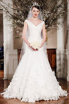 Photos: Wedding Dresses for a Ruler Body Create curves with this mermaid ball gown made of silk organza. The draped bodice and v-neckline adds shape to your bustline. The dropped waist skirt gives the impression of a curvy lower half, while the silk organza flowers adorning the skirt turns up the volume.  Visit us at http://www.youbeauty.com/