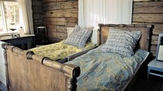 Rustic, old beds. Botanical theme covers. Fabric design: Amy Buttler.