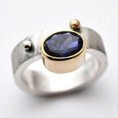 blue: the south's premier modern jeweler, exclusively showcasing one-of-a-kind pieces in susan west's iconic, modern designs. www.bluegoldsmiths.com #iolite #purple #handmade #conflictfree #somethingblue #bluebysusanwest #susanwest