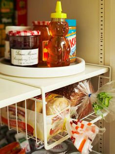 A lazy Susan makes it easy to find condiments that otherwise get pushed to the back of the pantry. More simple storage solutions: http://www.bhg.com/decorating/storage/organization-basics/simple-storage-for-less/?socsrc=bhgpin060213lazysusan=3