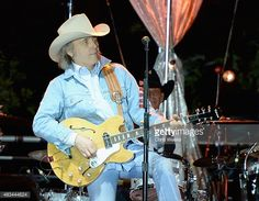 Musician Dwight Yoakam performs onstage during the Annenberg Foundation and KCRW's 'Sound In Focus' Concert Series, with Dwight Yoakam and X at Annenberg Space For Photography on August 8, 2015 in Century City, California.