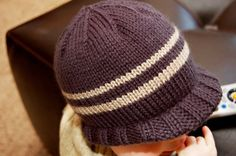 I knit this super simple hat for Chewy, my youngest. It's sooooo cute on him!!! Below is the pattern. For the brim, I actually dismantle...