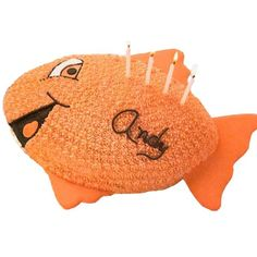 Thrill 'N Gills Cake - A smiling salmon swims into view with this football shaped cake. Color flow fins are piped and dried ahead of time to shorten your decorating time on the day of the party.