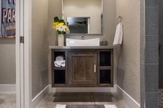 In this small bathroom designed by Jordan Iverson, a floating vanity takes up less visual space without compromising style. A pocket door, instead of a standard swinging door, lends privacy to the bathroom while freeing up floor space.