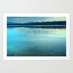 Blue sunset at the lake Art Print by Guido Montañés - $24.96