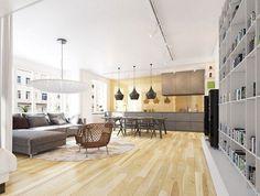 canapé gris ardoise avec méridienne, suspensions design et plancher massif