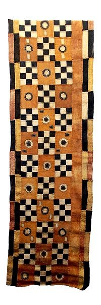 """KUBA, NGEENDE DANCE SKIRT. Kuba skirts, Tcaka, long are cloths made from raffia, from 8 - 25 feet long, from the Ngeende, Bushoong and Ngongo peoples. They incorporate appliqued """"patches"""", embroidered shapes and patterns, openwork, tie-dye, cowrie shells, barkcloth and border elements."""