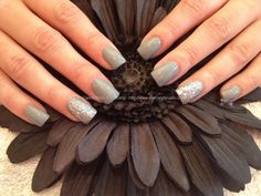 Acrylic nails with grey polish and glitter on ring