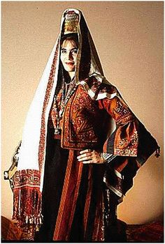 Bethlehem «Malak Khdari» or «Royal» dress and the «Shatweh» headdress with a  19th century striking headscarf. An authentic Palestinian dress in all its originality and beauty.