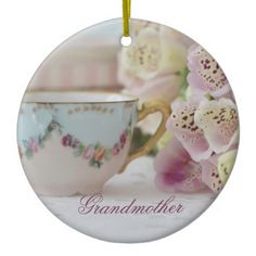 Grandmother Christmas Ornament featuring a pretty vintage tea cup and beautiful foxgloves  , dreamy romantic photography. A place for your special note on the rear side.  #grandmother #christmasornament #teacup #foxgloves