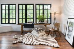 Hand-tufted in India of 100% polyester, the Zulu Collection is a modern interpretation of the chic safari zebra rug with an emphasis on exceptional comfort. These plush, playful rugs feature an irresistibly soft texture, making for an ideal living room or bedside rug.