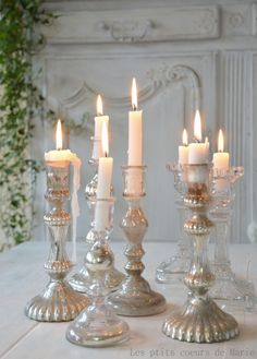Candle grouping for stair landings? Love the mix/match of different holders and heights.