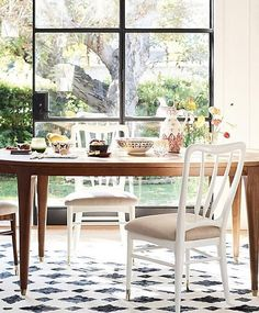 Walcotte Round Dining Table. A dreamy spot for breakfast. Like the most amenable dinner guest, an understated table is endlessly adaptable, allowing you to swap and style settings and seating as you please.