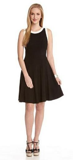BLACK AND WHITE CONTRAST BINDING DRESS This sleeveless Karen Kane dress flirts with a fit and flare silhouette and cool contrast trim. #Black_and_White #Karen_Kane #LBD #Summer #Fashion