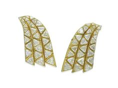 A Pair of Diamond 'Chutes' Earrings, By Marina B.    Each designed as three articulated gold bands set with graduated triangular-cut diamonds, circa 1978, 6.0 cm  Signed Marina B., no. L2535