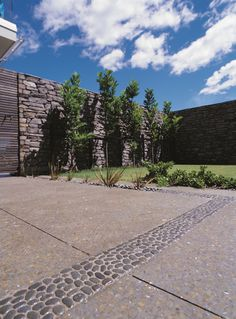 Very rare honed coloured concrete driveway (we wish there were more of them).  Designed by Bill Holden - more at www.peterfell.co.nz