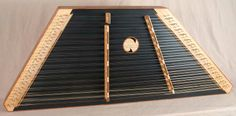 """This James Jones Custom 16/15 with 1"""" string spacing has a Walnut frame with Sycamore pin panels, a Redwood soundboard made black with Bubinga trim. Bridges are Cherry"""