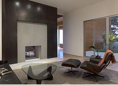 Modern Fireplace Design Ideas white barn interior door closed to narrow built in bookshelf aside modern fireplace design marble fireplace ideas with fireplace 1000 Images About Contemporary Fireplace Designs On Pinterest Contemporary Fireplaces Modern Fireplaces And Contemporary Living Rooms