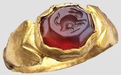 Gold ring with carnelian gem rabbit on, Roman, 3rd Century.