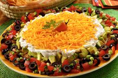 HAPPY CINCO DE MAYO RECIPES ... Mexican Fiesta Dip Recipe ~ INGREDIENTS: Refried beans - Avocados - Lemon juice - Salt and pepper to taste - Sour cream - Sargento® Fine Cut  - Shredded Mild Cheddar Cheese - Chipotle chilies in adobo sauce* - Green onions - Tomatoes - Black olives - Tortilla chips