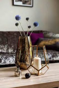 With its ornamental metal and glass frame, this gold pentagonal tea light holder provides a unique accent to your interior decor. Place a round tea light candle inside and light to enjoy atmospheric lighting at home. H22xDia.20cm.   Tesco
