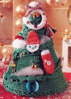 Cute Crochet Christmas Tree. Crochet this cute little tree decorated with a Santa face, wreath and more! Free Pattern More Patterns Like This!