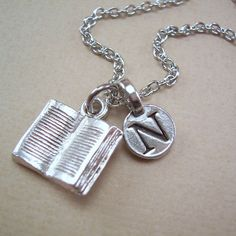 Hey, I found this really awesome Etsy listing at https://www.etsy.com/listing/161140024/personalized-book-charm-necklace