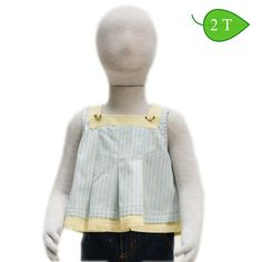 Yellow Rosebud -- Pleated swing tops will have your toddler feeling cool and looking cooler. The cotton top is buttoned all the way down the back adding to its classic design. ($15)