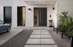 We've put together some of our favorite outdoor pool tile and patio tile ideas to help you get inspired in your own backyard! Modern Entrance Door, Outdoor Tiles, House Entrance, House Front, House Exterior, Modern Landscaping, Modern House Exterior, House Designs Exterior, Driveway Design