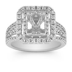 This stylishly stunning double halo engagement ring boasts 124 round diamonds, at approximately .88 carat total weight, crafted in quality 14 karat white gold.  Hand-matched for supreme sparkle and fire, these gems rising up the split shank setting will perfectly accent the princess cut diamond of your choice at approximately 1 carat.  Please contact a customer service representative for additional information or questions regarding your center stone selection.
