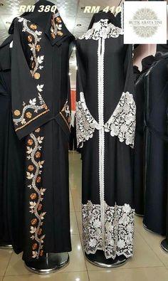 White laced black abaya.
