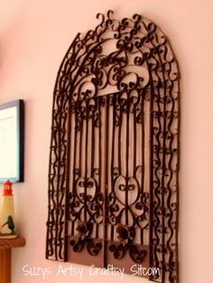 faux iron gate made from toilet paper tubes / suzys artsy craftsy sitcom.  I think I just found a wall feature to go with my photographs of Charleston's iron gates...wow...