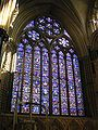 One of England's largest windows, the east window of Lincoln Cathedral, Ward and Nixon (1855), is a formal arrangement of small narrative scenes in roundels