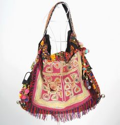 http://www.artfire.com/ext/shop/studio/bohemiantouch/1/1/7262//  Bohemian Hippie look Handmade Women vintage tribal fabric 100% handmade Beautiful Casual Chic Multicolor Boho Bag made from vintage hill tribe fabric.