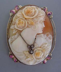 I love this cameo, particularly the necklace that she's wearing.  Notice the tiny pink enameled butterflies of the filigree frame.