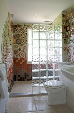 strongly considering a glass block divider like this for my small master bath... the rooms not big enough to worry much about heat loss ;) MUST have = same tile flooring throughout and curbless entry