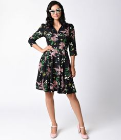 Delicately enveloping you in a bouquet of florals, the Charlotte dress from Emily & Fin is a blossoming dream! A sensational shirt dress in a black and floral print throughout, this knit frock boasts modest sensibilities, featuring a charming button-throu