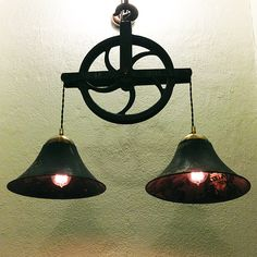 Lamp made out of American pulley wheel and two Magnavox phonograph horns. More industrial lamps and vintage home decor at www.rustyremakes.com.