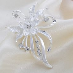 Beautiful Exquisite Silver Rhinestone Flower | High-quality Wedding Brooch $ 1.99 and FREE Shipping  Tag a friend who would love this!  Active link in BIO  #weddings #weddingfun #weddingday #wedding #weddinggift #weddingflowers #weddingplanner #weddingideas #weddingdecor #weddingceremony #weddingseason 	#weddingfun #weddinttime #weddinghair #weddingstyle #weddingbouquet #weddingsouvenir	 #weddingfavours #weddings #weddingideas #bride #bridal #bridesmaid #brideandgroom #bridesmades…