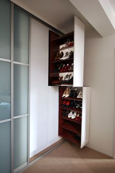 These pull out shoe racks provide neat bespoke storage for a burgeoning collection of footwear. The featureless rack fronts allow these elements to disappear completely into the fabric of the space merging with the wall. Closet Bedroom, Shoe Closet, Interior Design Kitchen, Interior Design Living Room, Shoe Cabinet Design, Ideas Armario, Entryway Decor, Bedroom Decor, Closet Designs