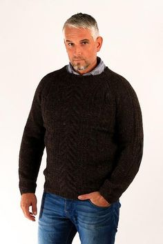 Gudbjartur pullover is hand knitted from Icelandic unspun wool yarn.  Its design is inspired by the classic Icelandic tradition of hand knitted wool sweaters.