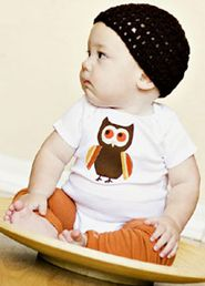 Loves owls, and this is the first time I have seen a boy pull off legwarmers, cute!
