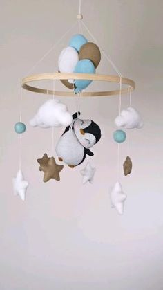 You can shop this item in my Etsy shop. All details linked there 😉 Handgemachtes Baby, Felt Baby, Baby Crib Mobile, Boy Mobile, Baby Mobile Felt, Baby Room Decor, Nursery Decor, Baby Shower Gifts, Baby Boy Gifts