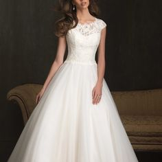 Style: 9058 - Soft and romantic, this ballgown is made of a delicate lace and tulle.  The scooped neckline features an off-the-shoulder cap sleeve with a v-shaped back and a chapel length train.