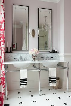 Designer  Sarah Richardson warms up this old-world inspired bath with a barely there shade of pink paint. Photo by Stacey Brandford.
