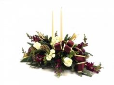 Home For The Holidays Centerpiece - A great centerpiece to have at the christmas table when you are home for the holidays. This lovely centerpieces brings together purples, whites and golds for a long and low presentation for flowers.